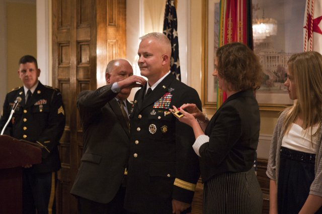 Under Secretary of the Army, Dr. Joseph W. Westphal, pins brigadier general rank on Brig. Gen. Burt K. Thompson with his wife Kala Thompson April13, 2012, at the Fort Myer Officer's Club on Joint Base Myer Henderson Hall, Va. Thompson's oldest daughter... http://www.army.mil/article/78018/Thompson_promoted_to_brigadier_general_in_the_U_S__Army/