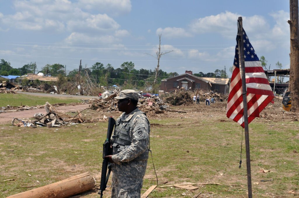 Army Pfc. Justin Jackson, of the Alabama Army National Guard's 1670th Transportation Company, provides flood response security for residents of Concord, Ala., May 9, 2011. Jackson is one of nearly 2,000 Guard members assisting with security, logistics, aviation and other support missions throughout Alabama's affected regions. (Alabama National Guard photo) (Released) http://www.nationalguard.mil/news/archives/2011/05/051011-Alabama.aspx