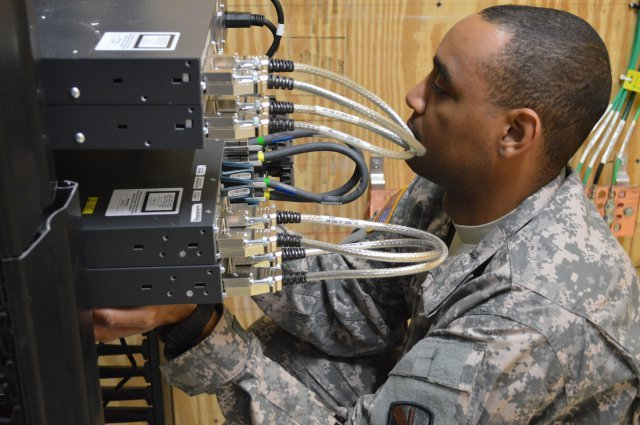 rmy , Air Force move data over same network for first time at Joint Base San Antonio Spc. Shannon January from the 56th Signal Battalion at Joint Base San Antonio-Fort Sam Houston, Texas, holds new switches in place while other technicians fasten them to a rack.http://www.army.mil/article/134148/Army__Air_Force_move_data_over_same_network_for_first_time_at_Joint_Base_San_Antonio/